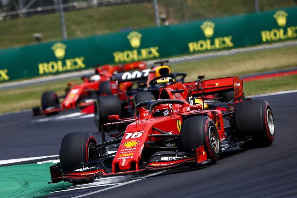 Charles Leclerc, Ferrari SF90 leads Max Verstappen, Red Bull Racing RB15 and Sebastian Vettel, Ferrari SF90