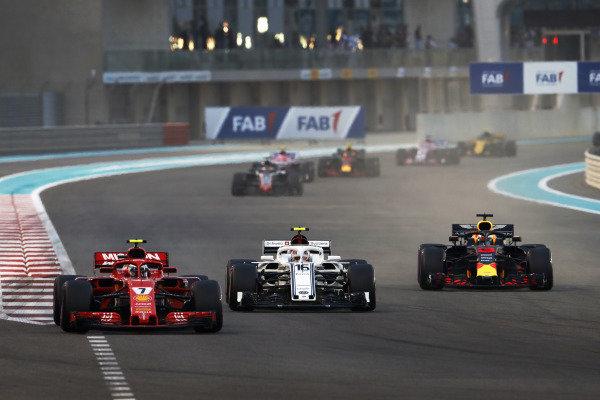 Kimi Raikkonen, Ferrari SF71H, Charles Leclerc, Sauber C37 Ferrari, and Daniel Ricciardo, Red Bull Racing RB14, battle at the start of the race