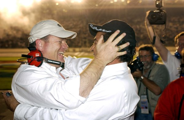 NASCAR Winston Cup UAW-GM Quality 500, Lowe's Motor Speedway, Concord,NC 13 October, 2002 Co-owners Chip Ganassi (L) and Felix Sabates hug following their rookie driver's (Jamie McMurry) unexpected win.Copyright-F Peirce Williams/MMP-Inc. 2002 LAT Photographic