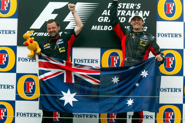 2002 Qantas Australian Grand Prix - RaceAlbert Park, Melbourne, Australia. 3rd March 2002Paul Stoddart and Mark Webber celebrate in front of their home crowd.World Copyright: Minardi/Copyright Freeref:11 7mb Digital Image Only