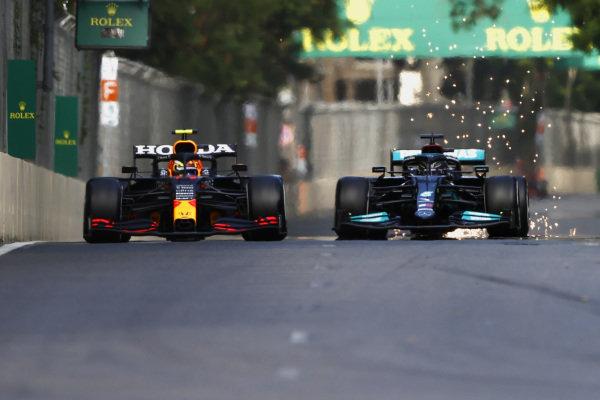 Sergio Perez, Red Bull Racing RB16B, battles with Sir Lewis Hamilton, Mercedes W12