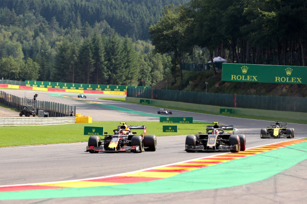 Alexander Albon, Red Bull RB15, battles with Kevin Magnussen, Haas VF-19