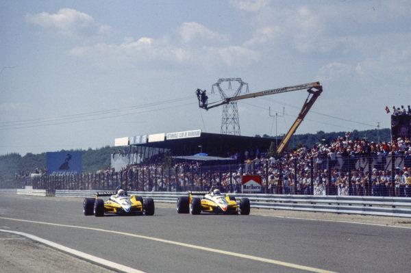 Alain Prost, Renault RE30B, battles with teammate René Arnoux.