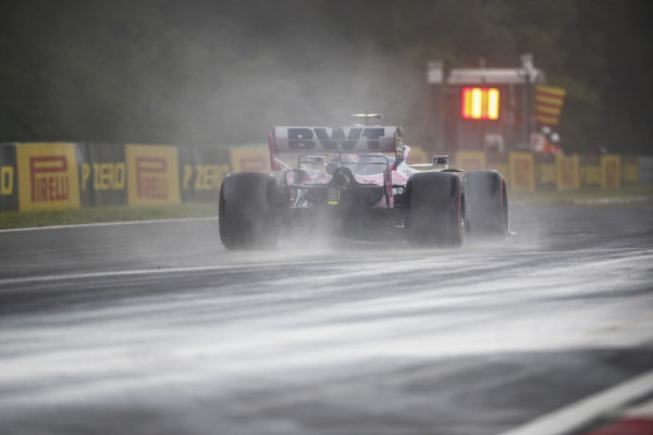 Lance Stroll, Racing Point RP19, kicks up cement dust which was laid down to cover a heavy oil spill in the F2 race prior to the session