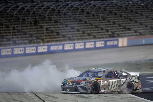 #18: Kyle Busch, Joe Gibbs Racing, Toyota Camry Skittles Zombie, celebrates after winning the Speedycash.com 400 at Texas Motor Speedway,