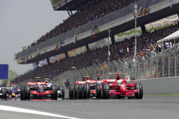Felipe Massa, Ferrari F2007 leads Fernando Alonso, McLaren MP4-22 Mercedes and Lewis Hamilton, McLaren MP4-22 Mercedes at the start.