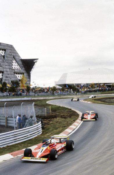 Carlos Reutemann, Ferrari 312T3 leads Gilles Villeneuve, Ferrari 312T3.