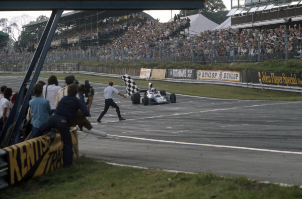 Jody Scheckter, Tyrrell 007 Ford takes the chequered flag for victory.
