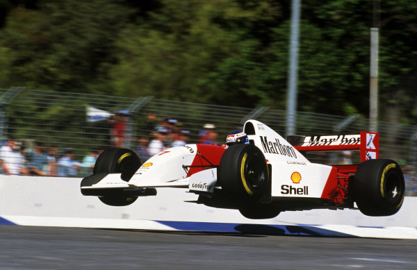 The Flying Finn Mika Hakkinen (FIN) launches his Mclaren MP4/8 into the air at the Malthouse Corner during a lap in practice. Formula One World Championship, Rd 16, Australian Grand Prix, Adelaide, 7 November 1993.