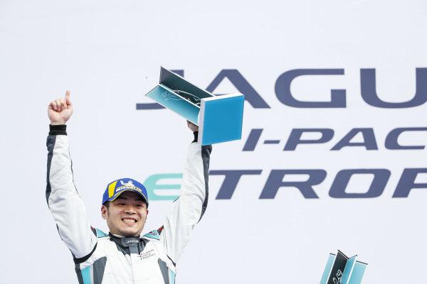 Yaqi Zhang (CHI), Team China, 1st position, celebrates on the podium