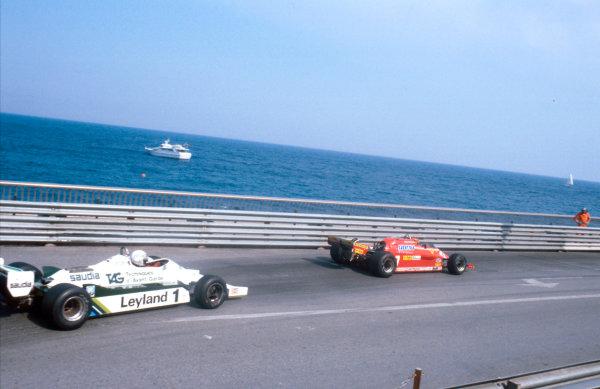 1981 Monaco Grand Prix. Monte Carlo, Monaco. 28-31 May 1981. Gilles Villeneuve (Ferrari 126CK) leads Alan Jones (Williams FW07C Ford) at Portier. Ref-81MON46. World Copyright - LAT Photographic