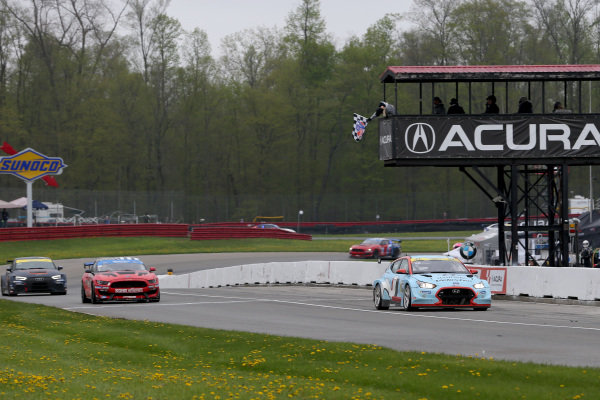 #98 Byan Herta Autosport W Curb-Agajanian Hyundai Veloster N TCR, TCR: Mark Wilkins, Michael Lewis crosses the finish line under the checkered flag for the win