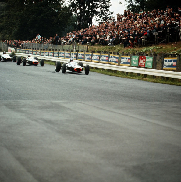 1965 German Grand Prix. Nurburgring, Germany. 1st August 1965. Graham Hill (BRM P261), 2nd position and Jackie Stewart, (BRM P261), retired lead Dan Gurney (Brabham BT11 Climax), action. World Copyright: LAT Photographic Ref-3/1822.