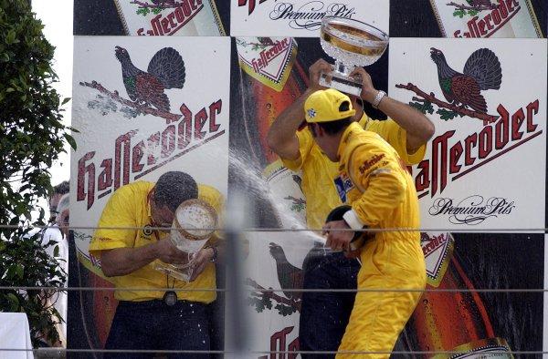 2002 DTM Championship Norisring, Germany. 29th - 30th June 2002. Race winner Laurent Aiello sprays champagne (Abt Audi TT-R), podium.World Copyright: Andre Irlmeier/LAT Photographic