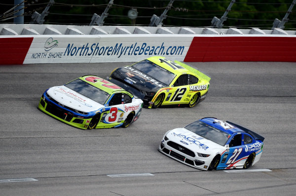 Austin Dillon, Richard Childress Racing Chevrolet Symbicort, leads Ryan Blaney, Team Penske Ford Mustang Menards/Duracell, and JJ Yeley, Rick Ware Racing Ford Jacob Construction Ford Copyright: Jared C. Tilton/Getty Images.
