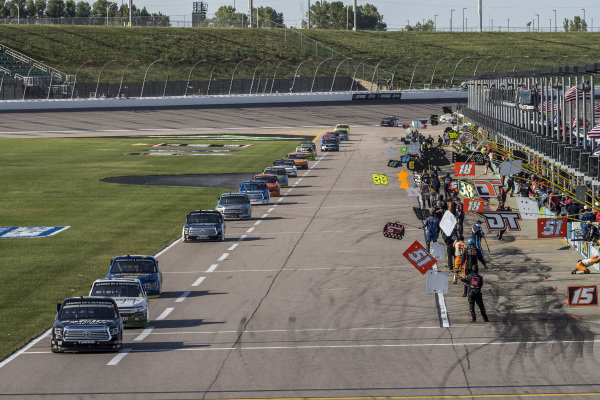 #18: Christian Eckes, Kyle Busch Motorsports, Safelite AutoGlass Toyota Tundra leads the field down pit road