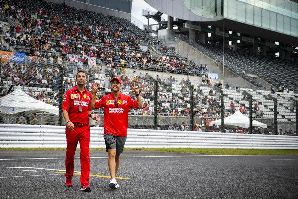 Sebastian Vettel, Ferrari waves to fans