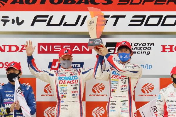 GT500 Winners Heikki Kovalainen & Yuichi Nakayama ( #39 DENSO KOBELCO SARD GR Toyota Supra ) celebrate on the podium with their trophhy