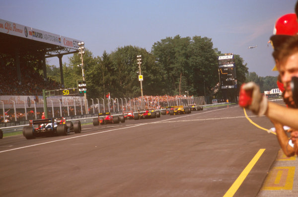 Monza, Italy.4-6 September 1987.The grid pulls away at the start of the race.Ref-87 ITA 07.World Copyright - LAT Photographic