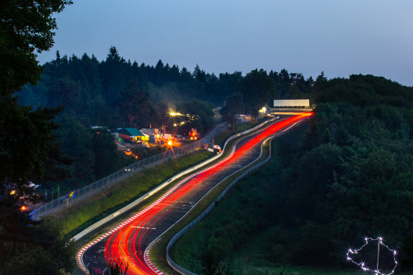 Trailing lights going up to Karussell, with a crude wire map of the Nurburgring in the corner with LED lights