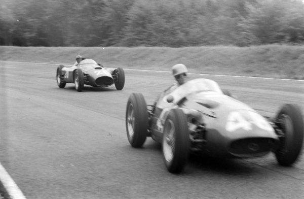 Umberto Maglioli/Jean Behra, Maserati 250F, leads Peter Collins/Juan Manuel Fangio, Ferrari D50.