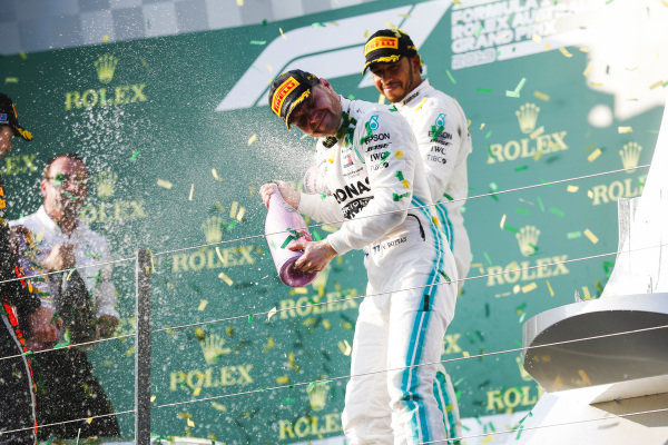 Valtteri Bottas, Mercedes AMG F1, 1st position, and Lewis Hamilton, Mercedes AMG F1, 2nd position, celebrate with Champagne on the podium