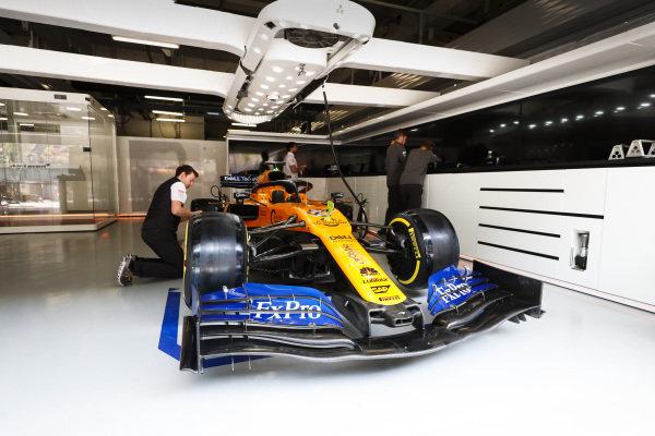 Car of Carlos Sainz Jr., McLaren MCL34 in the McLaren garage
