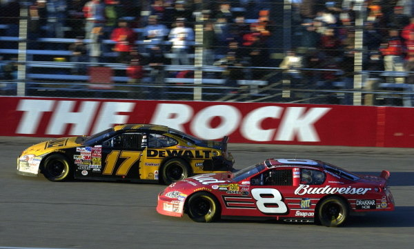L-R: 2003 Winston Cup Champion Matt Kenseth (USA), Smirnoff Ice/DeWalt Ford Taurus, and Dale Earnhardt Jr. (USA), Budweiser Chevrolet, race side by side at Rockingham.