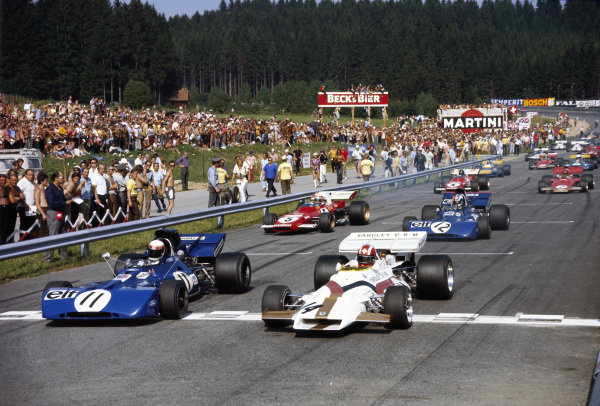 Jo Siffert, BRM P160, leads Jackie Stewart, Tyrrell 003 Ford, at the start with François Cevert, Tyrrell 002 Ford, and Clay Regazzoni, Ferrari 312B2, behind.