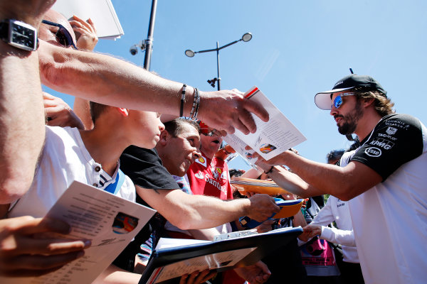 Monte Carlo, Monaco. Friday 22 May 2015. Fernando Alonso, McLaren, signs autographs for fans. World Copyright: Steven Tee/LAT Photographic. ref: Digital Image _X0W9756