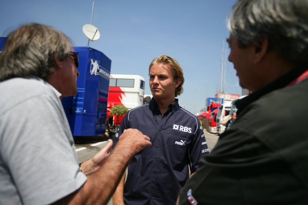 2006 Spanish Grand Prix - Thursday PreviewCircuit de Catalunya, Barcelona, Spain.11th - 14th May 2006Nico Rosberg, Williams FW28 Cosworth with Jacques Laffite and journalist Jean Louis Monsette.World Copyright: Glenn Dunbar/LAT Photographicref: Digital Image YY8P0945