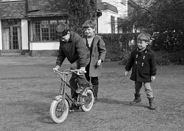 The 3 Brabham Boys, Gary Brabham, Geoff Brabham and David Brabham, playing in the garden of their house Surrey, England, 1970