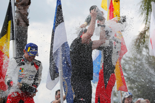 Tommi Makinen celebrates  with Ott Tanak after victory on Rally Argentina