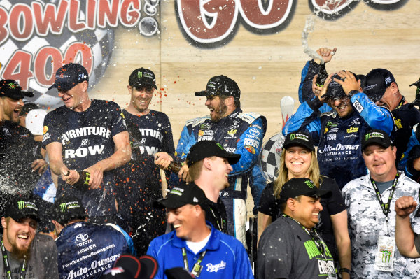 Monster Energy NASCAR Cup Series Go Bowling 400 Kansas Speedway, Kansas City, KS USA Sunday 14 May 2017 Martin Truex Jr, Furniture Row Racing, Auto-Owners Insurance Toyota Camry celebrates his win in Victory Lane World Copyright: Nigel Kinrade LAT Images ref: Digital Image 17KAN1nk09841