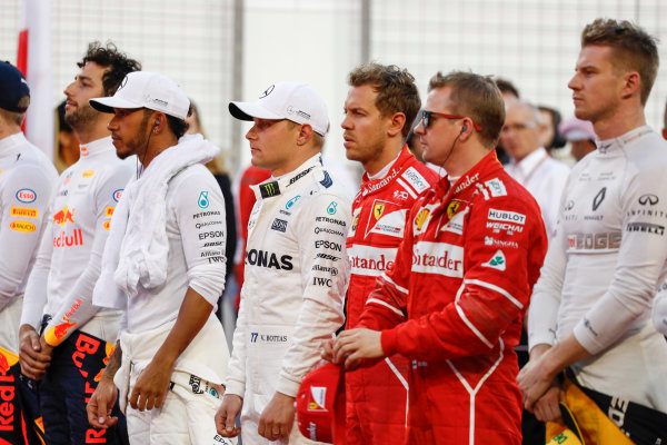 Bahrain International Circuit, Sakhir, Bahrain.  Sunday 16 April 2017. Daniel Ricciardo, Red Bull Racing,Lewis Hamilton, Mercedes AMG, Valtteri Bottas, Mercedes AMG, Sebastian Vettel, Ferrari, Kimi Raikkonen, Ferrari, and Nico Hulkenberg, Renault, line up for the national anthem. World Copyright: Glenn Dunbar/LAT Images ref: Digital Image _X4I1552