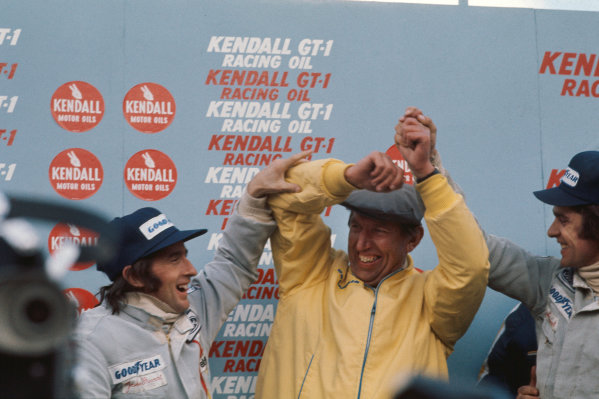 1972 United States Grand Prix.  Watkins Glen, New York, United States. 6-8th October 1972.  Ken Tyrrell celebrates a 1-2 finish on the podium with his drivers Jackie Stewart and François Cevert.  Ref: 72USA36. World Copyright: LAT Photographic