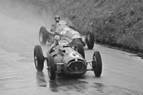 1951 Swiss Grand Prix.Bremgarten, Berne, Switzerland. 27 May 1951.Yves Giraud-Cabantous (Lago-Talbot T26C) leads Juan Manuel Fangio (Alfa Romeo 159) in the rain. Ref-C29185.World Copyright - LAT Photographic
