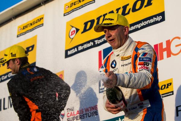 2015 British Touring Car Championship, Silverstone, Northamptonshire, England. 26th - 27th September 2015. Rob Collard (GBR) WSR BMW 125i M Sport, 2nd position, on the podium. World Copyright: Zak Mauger/LAT Photographic. ref: Digital Image _L0U4885