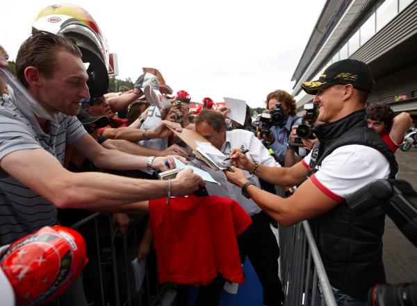 Spa-Francorchamps, Spa, Belgium 25th August 2011. Michael Schumacher, Mercedes GP W02, signs autographs for fans. Portrait. Atmosphere.  World Copyright: Steve Etherington/LAT Photographic ref: Digital Image SNE26463
