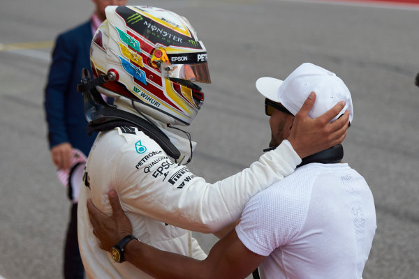 Circuit of the Americas, Austin, Texas, United States of America. Saturday 21 October 2017. Lewis Hamilton, Mercedes AMG, celebrates with his brother Nick, after securing pole position. World Copyright: Steve Etherington/LAT Images  ref: Digital Image SNE18984
