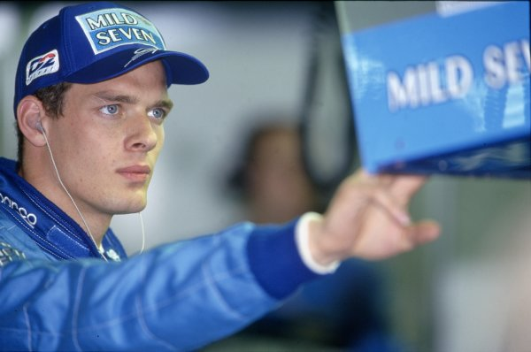 1998 Italian Grand Prix.Monza, Italy. 13 September 1998.Alexander Wurz, Benetton B198-Mecachrome, retired, looks at the timing monitor, portrait.World Copyright: LAT PhotographicRef: 35mm transparency