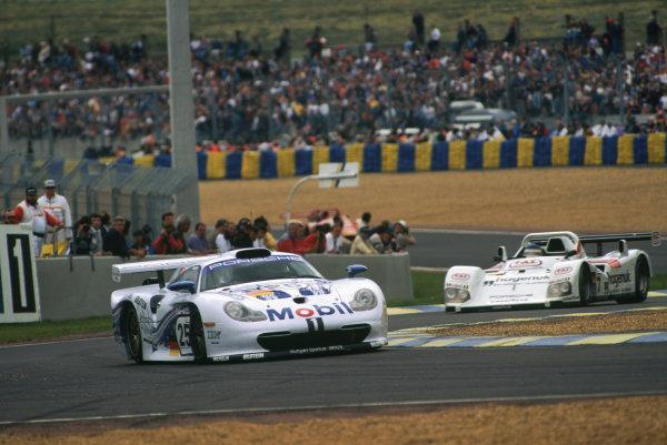 Le Mans, France. 14th - 15th June 1997.Bob Wollek/Hans-Joachim Stuck/Thierry Boutsen (Porsche 911 GT1), retired, leads Tom Kristensen/Stefan Johansson/Michele Alboreto (TWR Porsche WSC 95), 1st position, action.World Copyright: LAT Photographic.Ref:  97LM07.