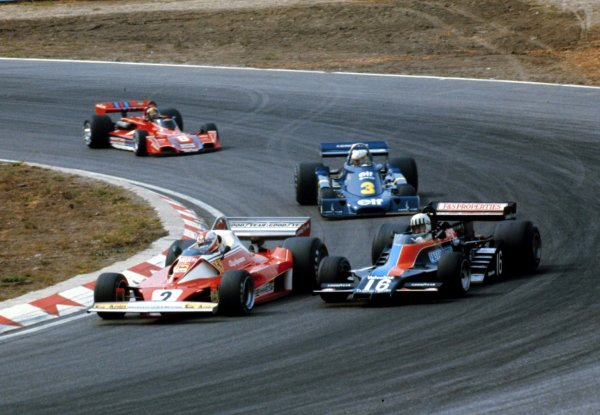 1976 Dutch Grand Prix. Zandvoort, Holland. 27-29 August 1976. Clay Regazzoni (Ferrari 312T) passes Tom Pryce (Shdow DN8A Ford) with Jody Scheckter (Tyrrell P34 Ford) following. They finished in 2nd, 4th and 5th positions respectively. World Copyright - LAT Photographic Ref: 76HOL12