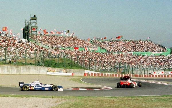 1996 Japanese Grand Prix.Suzuka, Japan.11-13 October 1996.Michael Schumacher (Ferrari F310) leads Mika Hakkinen (McLaren MP4/10B Mercedes-Benz) and Jacques Villeneuve (Williams FW19 Renault).World Copyright - LAT Photographic