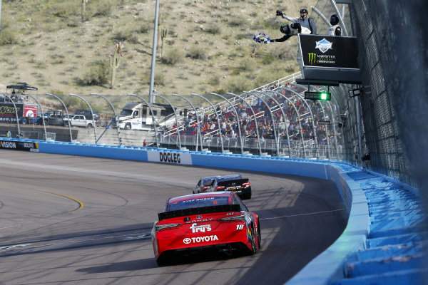 #18: Kyle Busch, Joe Gibbs Racing, Toyota Camry SKITTLES drives under the checkered flag to win