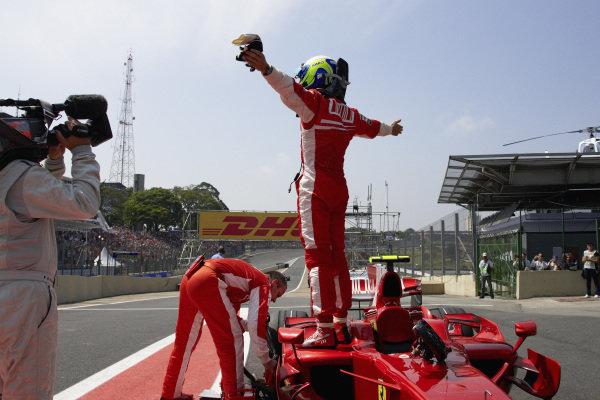 Felipe Massa celebrates pole position in parc ferme.