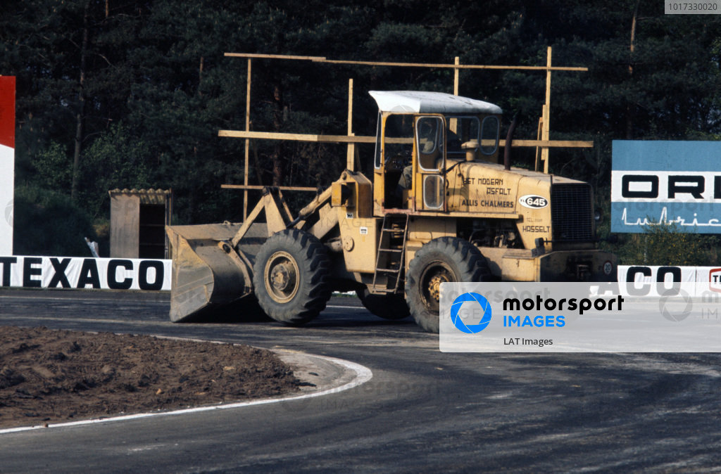 A mechanised excavator at work on the circuit, which was hastily resurfaced in the build-up to the race.