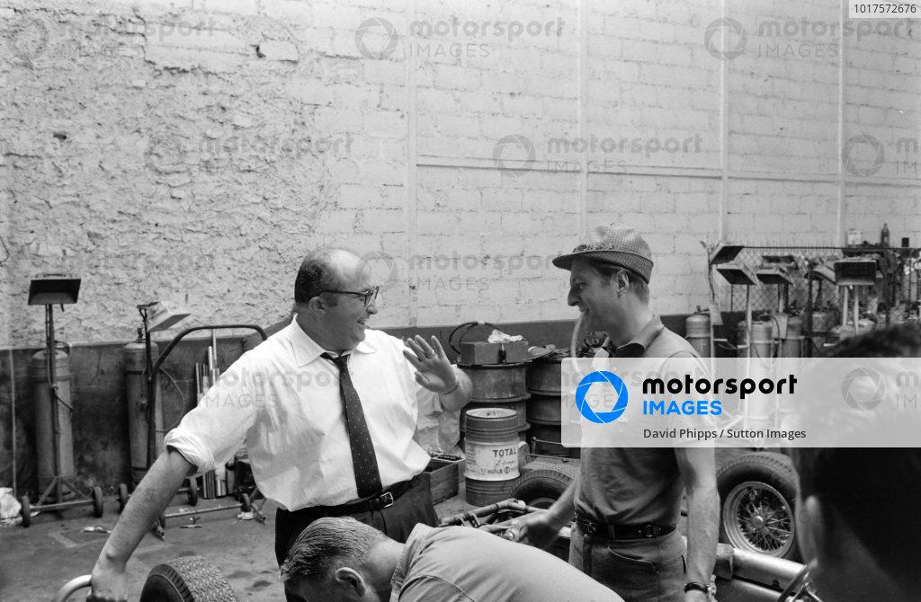 Ferrari 156 designer, Carlo Chiti shares a joke with Wolfgang von Trips.