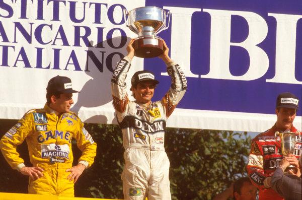 Monza, Italy.4-6 September 1987.Nelson Piquet (Williams Honda) 1st position, Ayrton Senna (Team Lotus) 2nd position and Nigel Mansell (Williams Honda) 3rd position on the podium.Ref-87 ITA 10.World Copyright - LAT Photographic