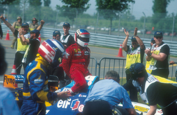 1995 Canadian Grand Prix.Montreal, Quebec, Canada.9-11 June 1995.Jean Alesi (Ferrari), 1st position for his maiden Grand Prix win, got a lift back to the pits upon the top of Michael Schumacher's car after his car stopped on the victory lap.Ref-95 CAN 02.World Copyright - LAT Photographic
